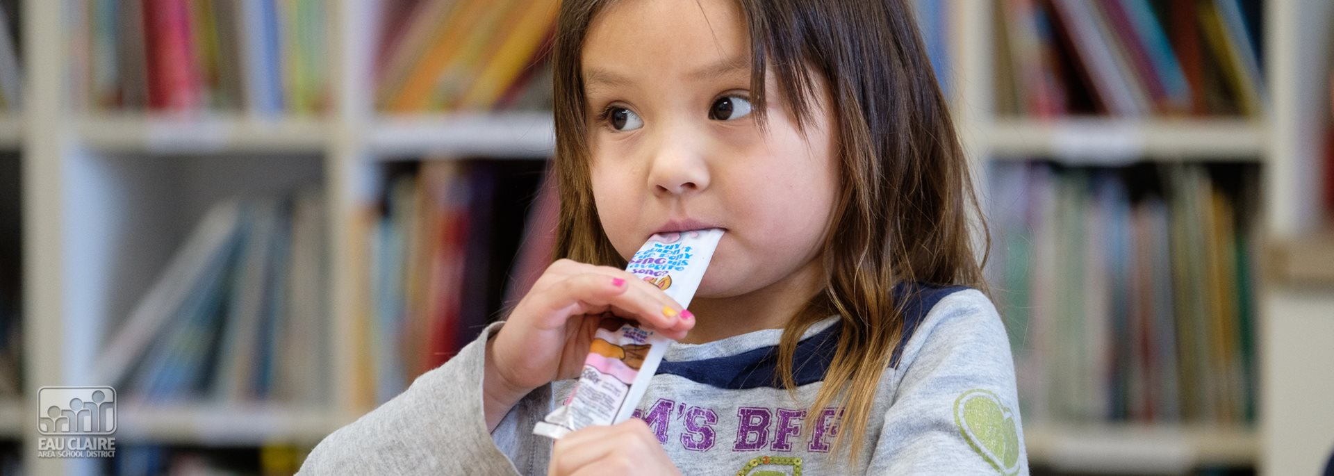 photo of student eating yogurt
