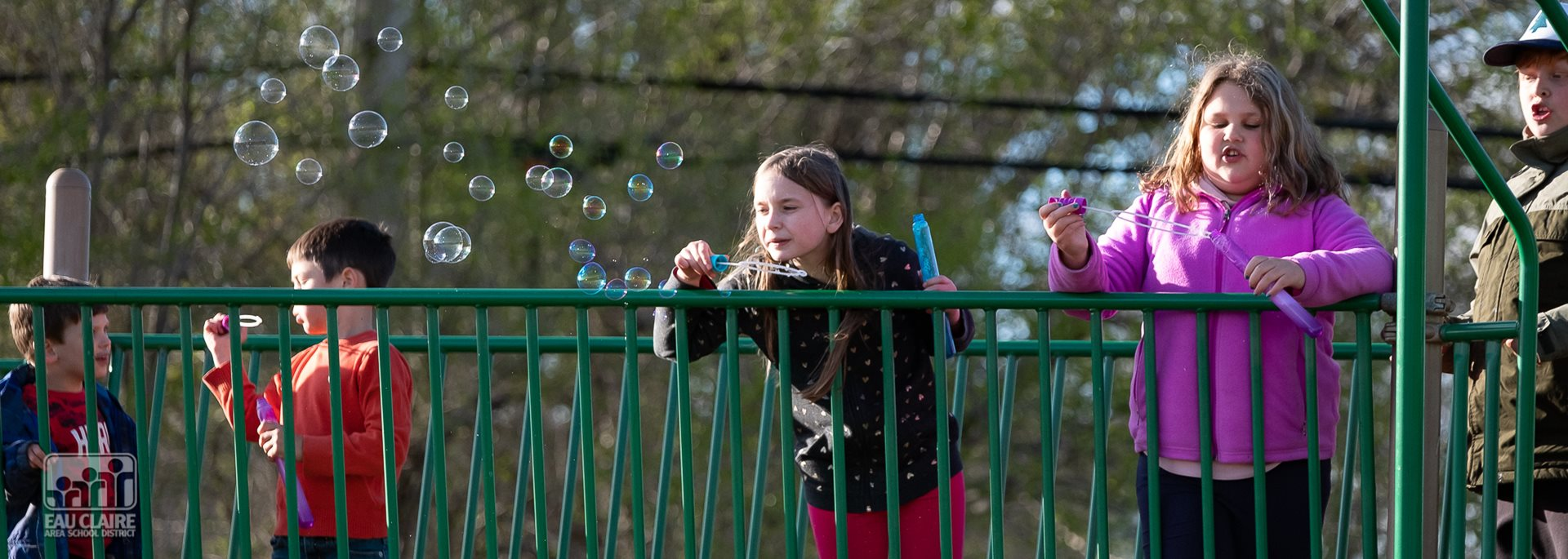 students blowing bubbles